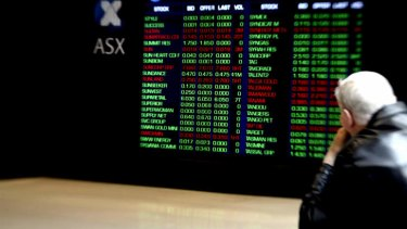 Investors view the ASX stock board on Bridge Street in Sydney.