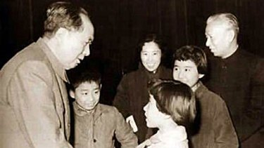Liu Yuan stands to the right of Mao Tse Tung as the Chinese leader greets his family in the late 1950s or early 1960s.