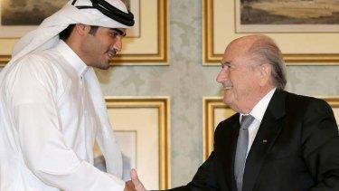 Chairman of the Qatar 2022 bid committee Sheikh Mohammed bin Hamad al-Thani shakes hands with FIFA president Sepp Blatter last week in Doha.