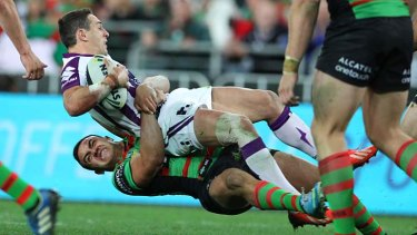 Back to earth: Melbourne Storm star Billy Slater is tackled during Friday night's controversial loss to South Sydney.