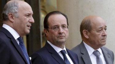 Francois Hollande, centre, with the Foreign Affairs Minister Laurent Fabius, left, and Defence Minister Jean-Yves Le Drian at the Elysee Palace in Paris this week.