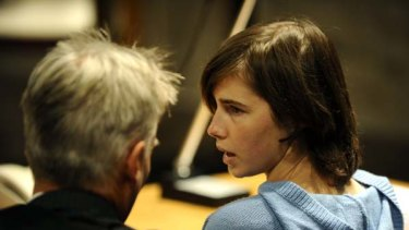Amanda Knox talks with her lawyer Carlo Dalla Vedova in the Perugia courthouse before the start of her appeal trial.
