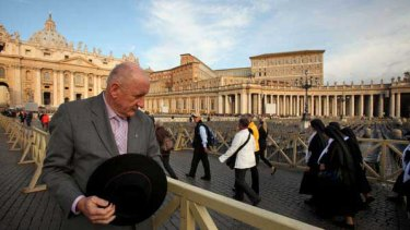 Tim Fischer takes in the scene in St Peter's Square this week. He describes himself as ''a less than perfect Catholic''.