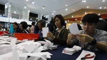 Electoral officials count ballots for the presidential election at a school in Seoul.