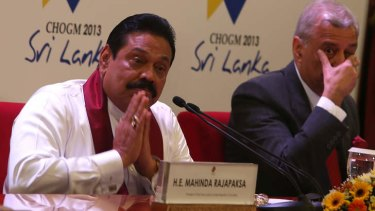 On the defensive: Sri Lankan President Mahinda Rajapakse greets journalists at his news conference with Commonwealth Secretary-General Kamalesh Sharma.