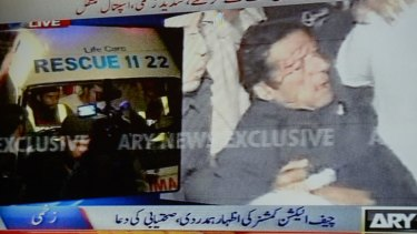 TV footage shows Imran Khan immediately after his fall.