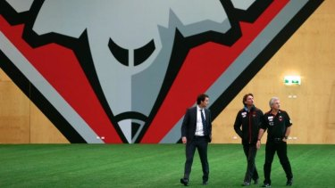 James Hird at Essendon's Tullamarine base, with Neil Craig (right) and Xavier Campbell.
