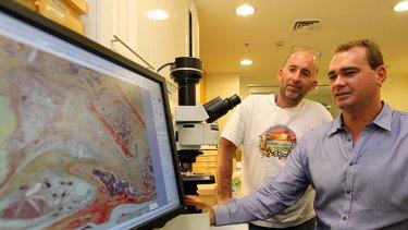 Plant cures ... Bill Walsh and Graham Matheson monitor bone regeneration.