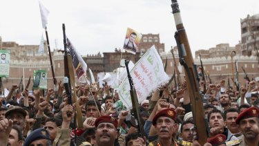 Houthi rebels hold up their weapons to protest against Saudi-led air strikes during a rally in Sana'a last week.