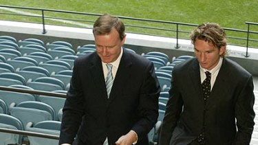 Peter Costello with Essendon great James Hird.