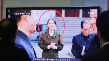 South Koreans watch a TV news program showing Kim Yo-jong, North Korean leader Kim Jong-un's younger sister, in 2014.