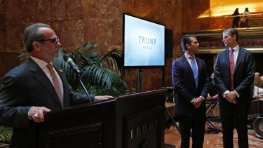 "Eric Danziger, head of Trump's hotels division, with Donald Trump Jr, centre, and Eric Trump, right, at an event to launch ""American Idea"", a new mid-market hotel chain last week."