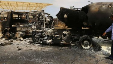 The wreckage of a truck and a plane at Tripoli International Airport.