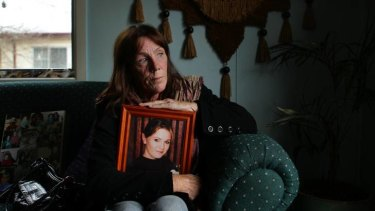 New search ... Ricki Small holds a photo of her daughter Jessica.