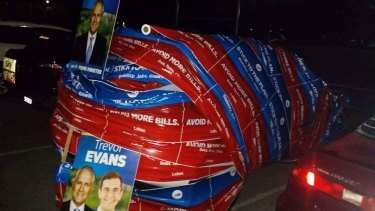 Member-elect for Brisbane Trevor Evans's brothers wrapped his car in election material at the height of Saturday night's celebrations.