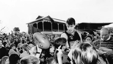 Jim Stynes is mobbed by fans in 1994.