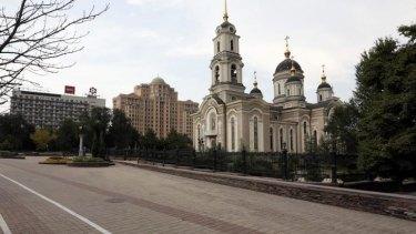 An empty street is seen in central Donetsk.