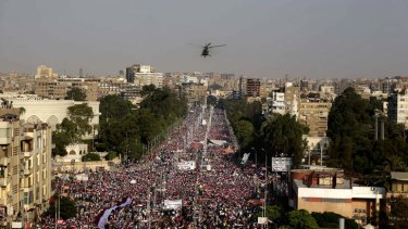 A military helicopter files over the presidential palace in Cairo.