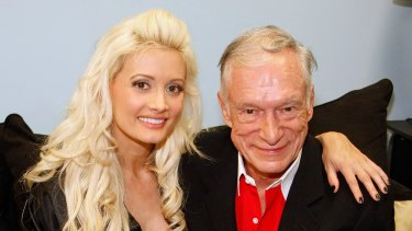 Squalid scenes: Holly Madison and Playboy founder Hugh Hefner in 2009.