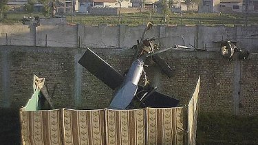Part of a damaged helicopter, lying near the compound where al-Qaeda leader Osama bin Laden was killed.