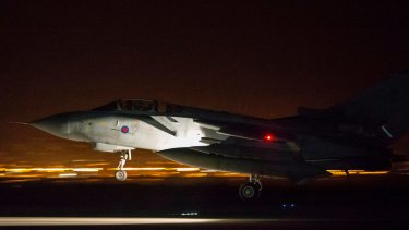 In this image released by Britain's Ministry of Defense, an RAF Tornado comes into land at Britain Royal Air Force base in Akrotiri, Cyprus, after its mission to conduct strikes in support of operations over the Middle East.