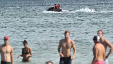 """Jet-skiers and swimmers at St Kilda beach yesterday. Port Phillip mayor Rachel Powning says council receives """"endless"""" complaints about jet-skis in Port Phillip Bay."""