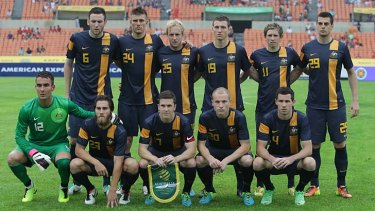 The Australian team poses before its East Asian Cup match against China.