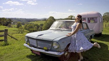 LADIES OF THE ROAD: Lisa Mora, her (then blue) Vauxhall Cresta and her vintage caravan ''Betty Page-Turner''.