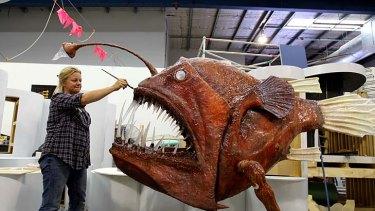 Dental work ... Australian Museum preparator Tina Mansson readies an oversized model anglerfish for the Deep Oceans show.
