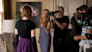 On the set: Cronenberg at work on <i>Maps to the Stars</i> with Mia Wasikowska (left) and Julianne Moore.