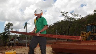 Opposition Leader Tony Abbott helps in the construction of a Bush Owner Builder project home near Hope Vale, Queensland.