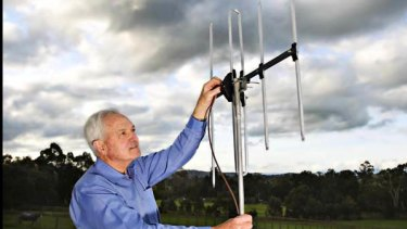 Graeme Redman from Pure Australasia adjusts an antenna.