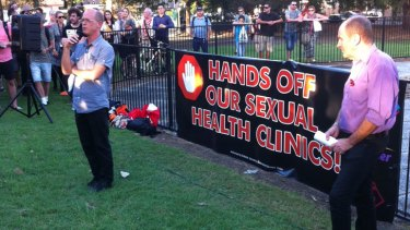 A man who has been using Biala House's sexual health services for more than 25 years addresses a crowd protesting job cuts at the sexual health clinic March.