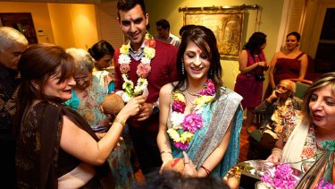 Happy families: Zoroastrians Ray Medhora and Binaifer Doodha at their pre-wedding celebration in St Ives on Thursday.