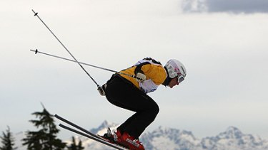 Flying  ... Jenny Owens takes to the air during a ski cross qualification event  near Vancouver last year; inset, the 31-year-old says the many bruising spills are just part of the sport.