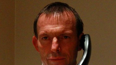 Marathon man ... Tony Abbott conducts a live radio interview by telephone at 2.45am