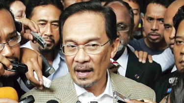 Anwar Ibrahim speaks to the media shortly before being arrested. He had been about to go to Kuala Lumpur police headquarters for questioning over sexual assault allegations. PICTURE: REUTERS