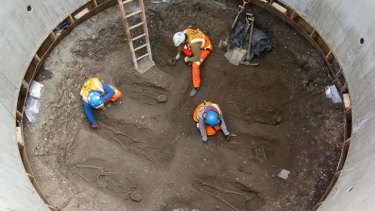 Archaeologists work to uncover skeletons from what is understood to be a mass grave for victims of the Black Death.