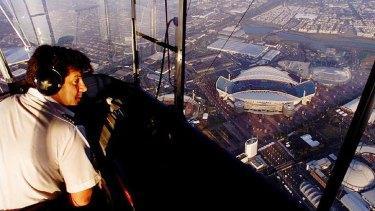Michael Nerandzic pilots an airship over Homebush Bay, Sydney, in 2000.