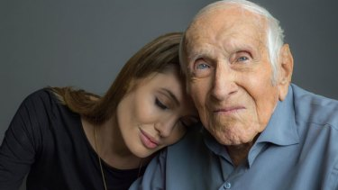 Angelina Jolie and Louis Zamperini, whose life story she will bring to the silver screen as director of <i>Unbroken</i>.