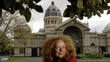Carolyn Morwood outside the Melbourne Exhibition Building, where the first book of her crime trilogy is set.