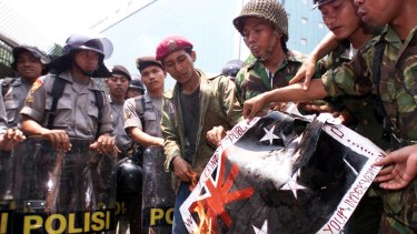 Indonesian children burn a mock Australian flag in 1999 in protest against Australia's intervention in East Timor.