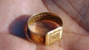 A golden ring with a Hebrew inscription is shown after being discovered at the Nazi's Sobibor death camp. Many personal items of victims were found at the bottom of a well.