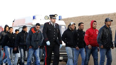 Exodus: Migrants from North Africa arrive on the Italian island of Lampedusa, which French National Front leader Marine Le Pen has said she will visit to highlight the immigration issue.