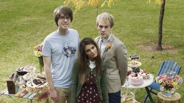 Josh (Josh Thomas, right), his boyfriend Geoffrey (Wade Briggs) and his ex-girlfriend Claire (Caitlin Stasey ) sidestep sitcom cliche in <i>Please Like Me</i>.