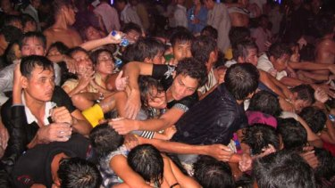 Stampede ... people try to scramble to safety.