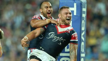 Up for the challenge: Jared Waerea-Hargreaves scores against Wigan on Saturday night.