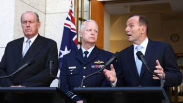 Prime Minister Tony Abbott announced Australia's involvement in air strikes, flanked by Defence Minister David Johnston and Chief of the Defence Force, Air Chief Marshal Mark Binksin, last Friday.