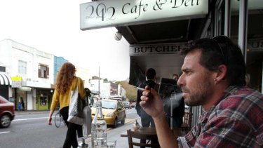 Restricted ... patron Gareth Johnson has a cigarette at 2042 Cafe & Deli on King Street, Newtown.