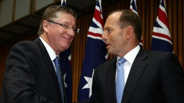 Happier times: Victorian Premier Denis Napthine and Prime Minister Tony Abbott after a Council of Australian Governments meeting.